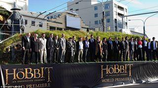 Hobbit actors on stage